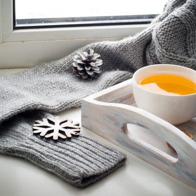 Cup of hot tea on the windowsill